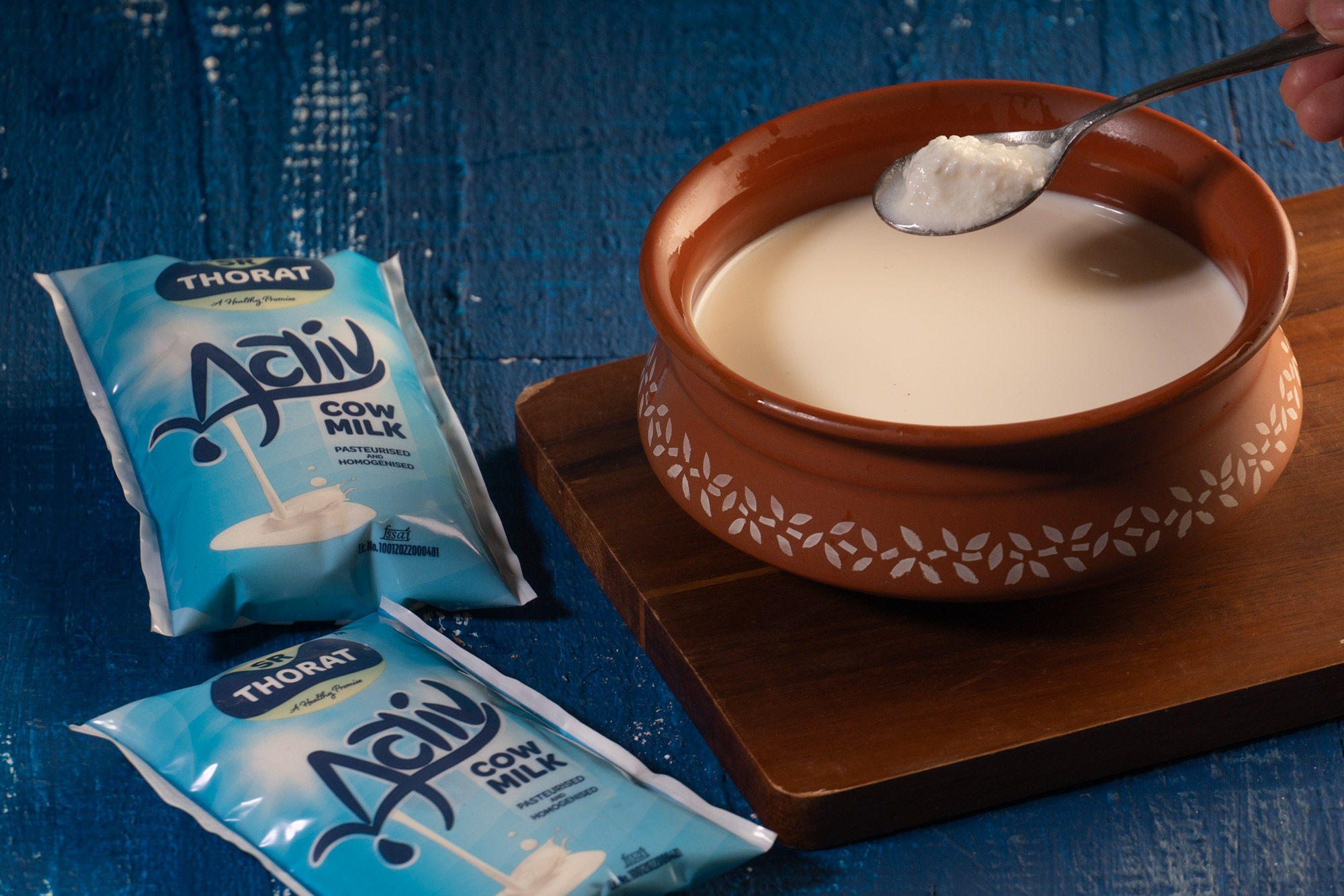 Add dahi to the milk